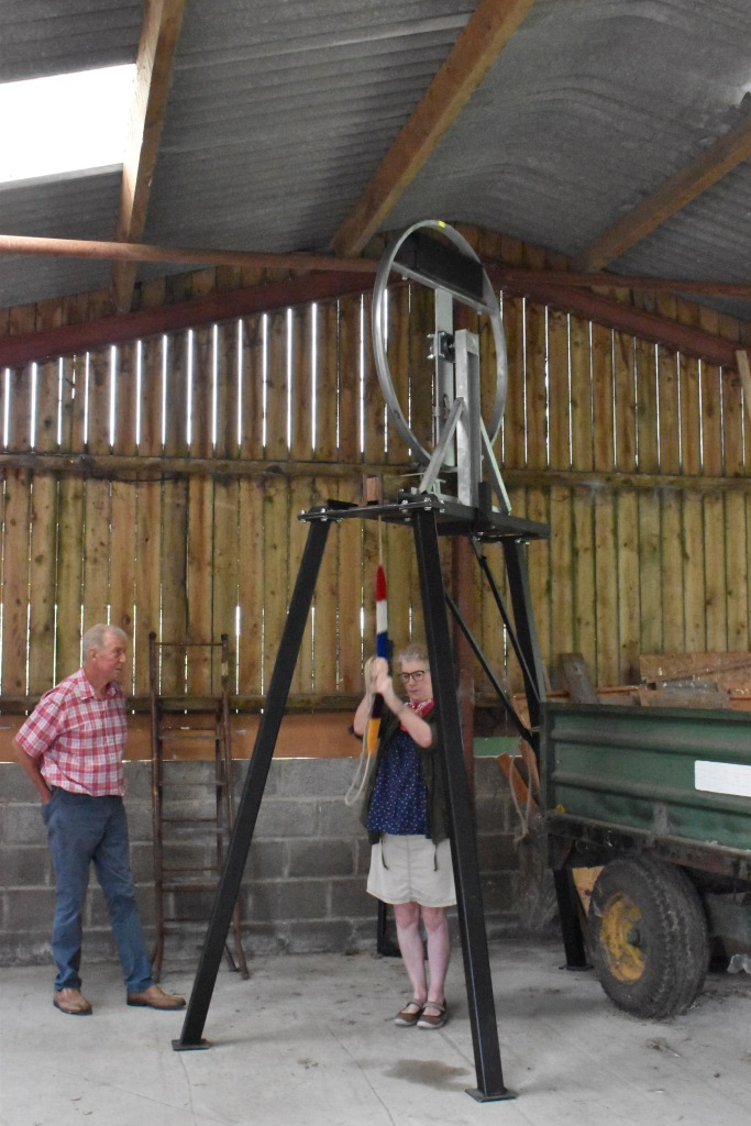 Photo of dumb bell in use, with Colin teaching Debbie