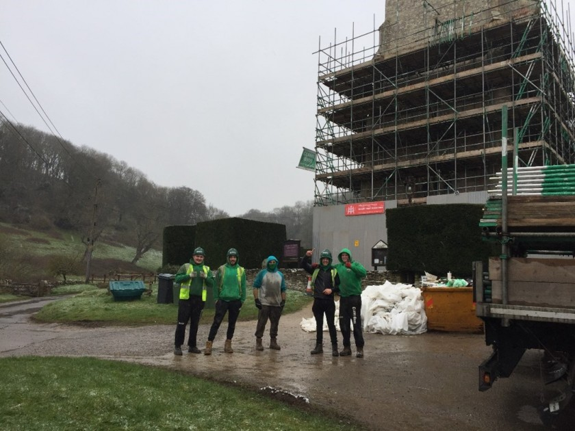 photo of conservation team outside the church in rain